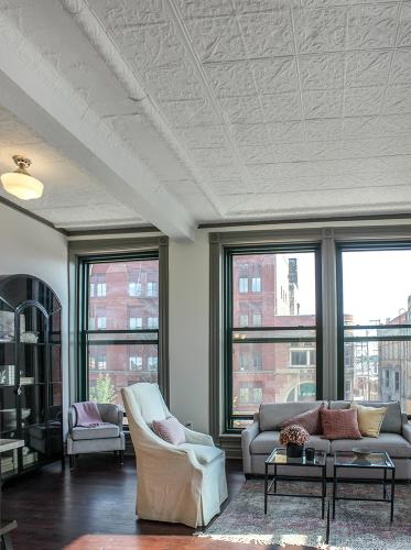 Apartment living space with view of Center Ave - The Legacy