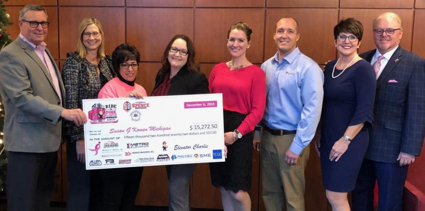 Presenting fundraiser check to Susan G Komen Michigan